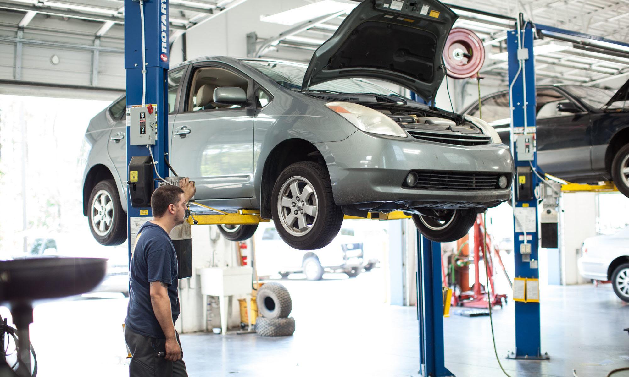 hybrid car on shop lift