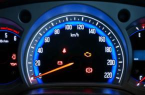 vehicle dashboard with warning lights