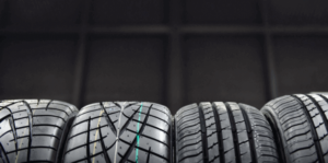 A horizontal line of new tires