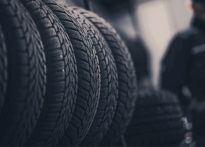 Four tires lined in a row, meant to represent different tire seasons