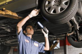 Mechanic completing a tire inspection