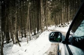 A car driving on a snow-covered road in the winter