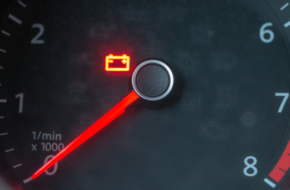 a car battery warning light on a dashboard