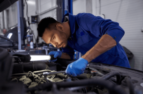 Mechanic Completing Engine and Transmission Service