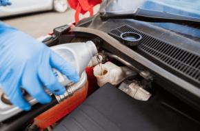 Mechanic completing a brake fluid flush