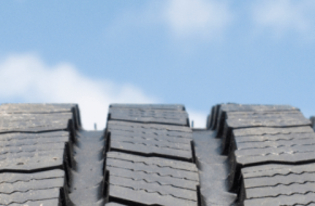 Tire tread against a sky background