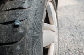 Picture of a screw puncturing a tire