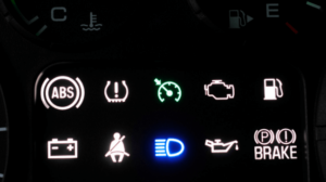 A dashboard lit up with warning lights